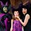 A mother and daughter pose next to Maleficent while wearing similar headwear as the Disney villain.